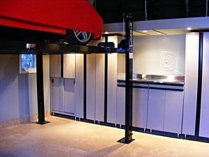 You can fit extra cars in your garage by installing a car lift. You will need garage doors that accommodate the extra height needed.